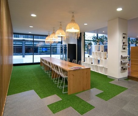 love the artificial turf and the tile mix in this creative sharing space