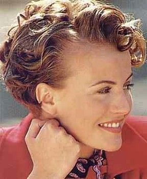 Cute short curly hair style - still has a bit of length on top but stays off the face