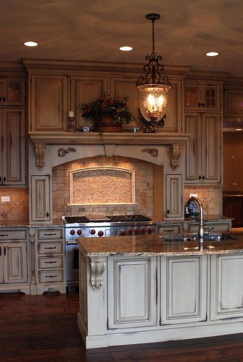 These cabinets are painted white with a chocolate glaze rubbed on them for  an antiqued effect. Large homes are