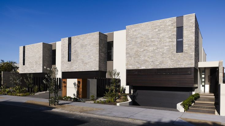 Mix of stone cladding and render