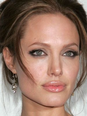 Angelina Jolie. Her CORRECTED nose made her Purrfect!  cameranaked.com