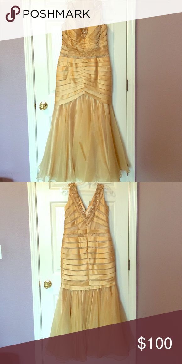 Mother of the bride dress Elegant and classy! Long, gold sequence in the front and back of this gorgeous dress. Dress is a large however fits a size 10/12. Very form fitting sally usa Dresses Wedding