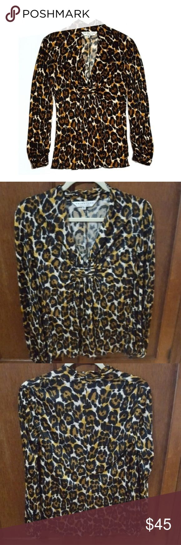 """Trina Turk Leopard Cheetah Print 100% Silk Top Pristine condition. Super soft. Beautiful leopard/cheetah design. V-neck. Wonderful details such as silk buttons at wrists. Dressy and classy.  Shoulder to shoulder approx 16"""" when flat, armpit to armpit 16"""", sleeve 24 1/4"""", length from shoulder 23.5""""  For reference, I'm 5'6 and 34-27-34 and this has a great fit. Trina Turk Tops Blouses"""