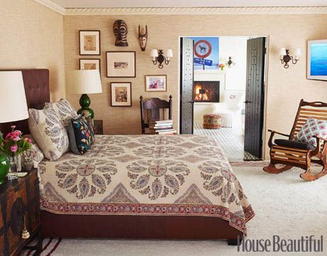 An Eclectic Bedroom  Designer Peter Dunham flipped the positions of the bedroom and bathroom, which is why the bathroom has a fireplace. On the bed, he used his own Samarkand spread and on the walls, grasscloth wallpaper.