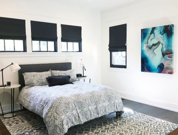 Black Roman Shades Look Crisp And Clean In This Bedroom Design By M. A.  Mitchell. |
