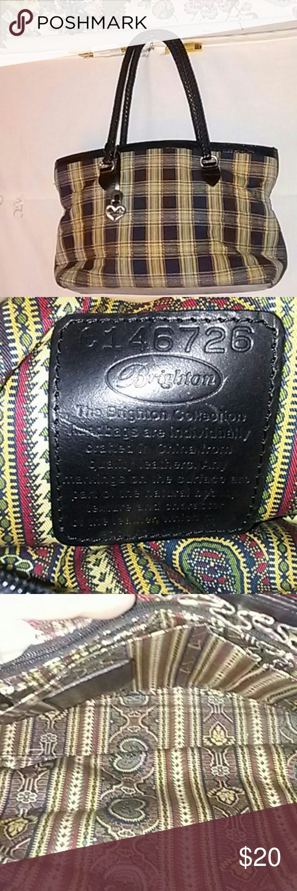 Brighton Multi-Color Striped Shoulder Bag Brighton Pre-owned Multi-Color Striped Shoulder Bag Inside: 2 pockets and 1 zippered pocket in middle Inside Back 2 slip pocket,1 pen pocket and 1 zippered pocket  Height: 9 inches Depth: 7 inches  Length:  11 inches  Strap drop:  10 inches  It has scratches in the bottom.  Normal wear from use. It good condition.  If you have any questions or you need anymore pictures please let me know. Thanks for looking. Brighton Bags Shoulder Bags