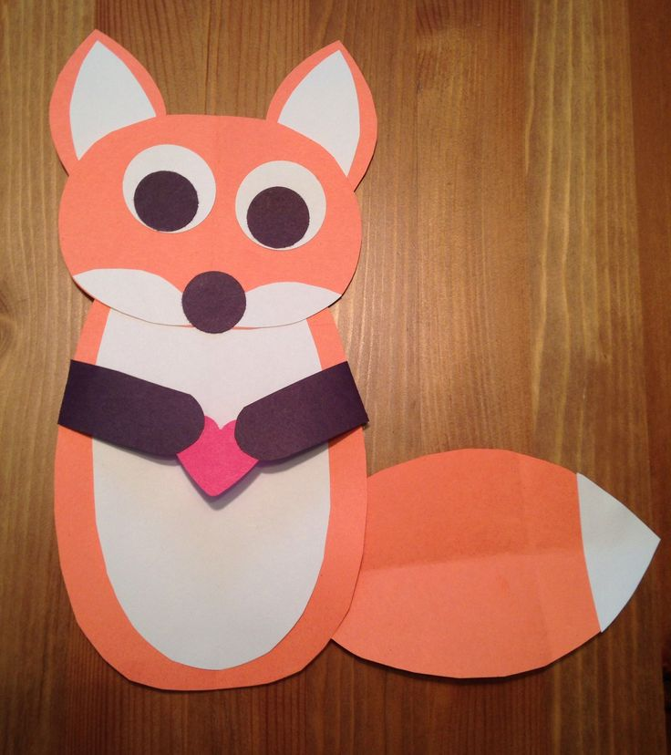 Fox Craft - Fox and the Hound Movie Night Craft - Disney Movie Night Craft - holding a heart to represent the friendship between Copper and Tod - Family Movie Night