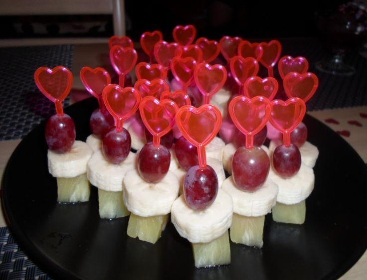 Dessert for Valentines day. Fruit on heart sticks.