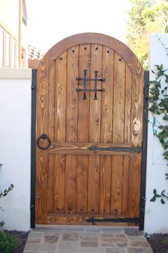 Spanish Style Wooden Gates | This 20ft wide, two-leaf Chaparral driveway gate…