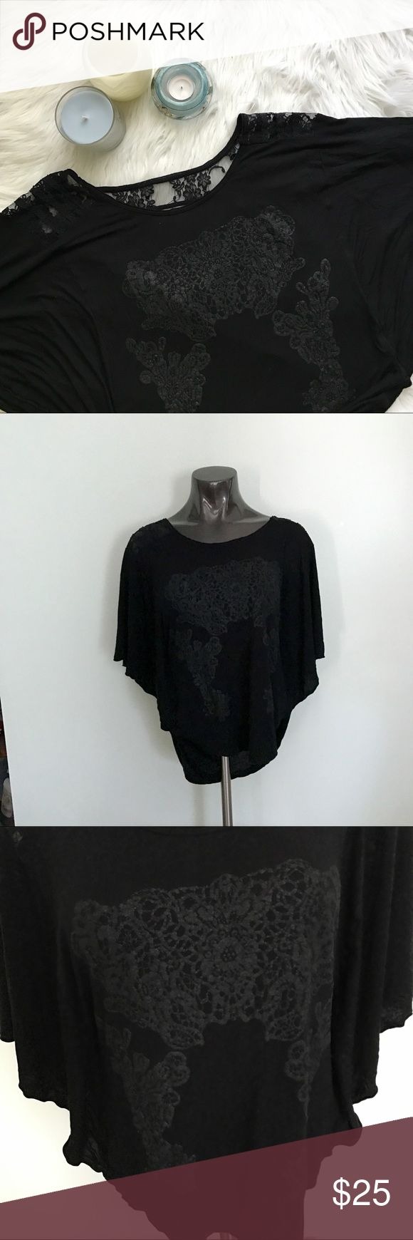 {FREE PEOPLE} Black Batwing Top 🦇 This flowy and fun Top is black with black graphics on the front. Cute Lace band in the back to keep the shirt from falling down. Draped back. Dolman/batwing sleeves. No noticeable flaws. Size small. Free People Tops Tees - Short Sleeve