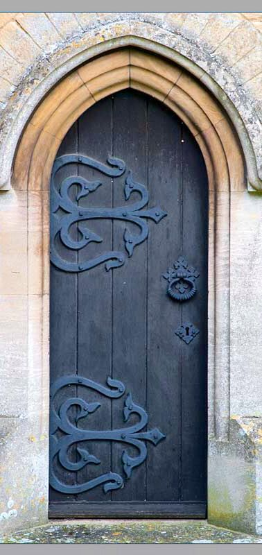 yet another amazing door with stunning decorative strap hinges
