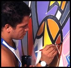 "Romero Britto combined influences from cubism with pop, to create a vibrant, iconic style that The New York Times describes, ""exudes warmth, optimism and love."""