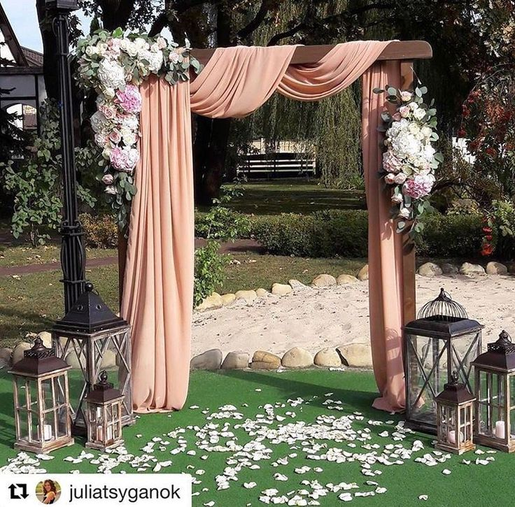 Pergola draping (in ivory), floral swag, lanterns