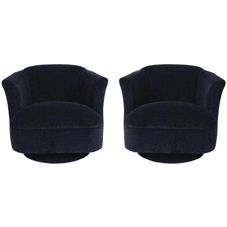 pair of navy blue velvet swivel club chairs