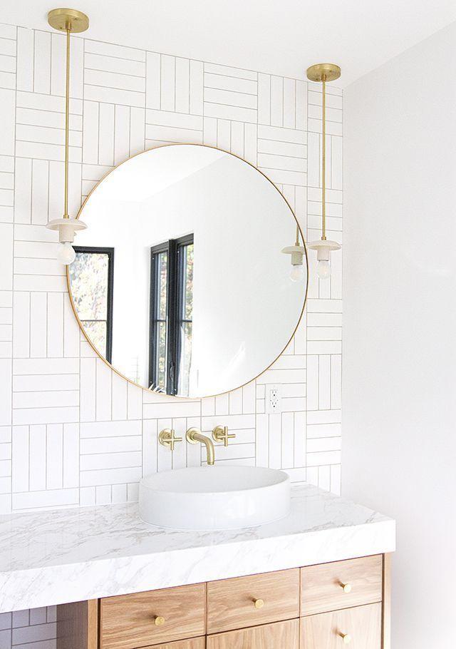 20 Ways To Style An Oversized Gold Round Wall Mirror Modern Bathroom Mirrors Bathroom Interior Design Modern Bathroom