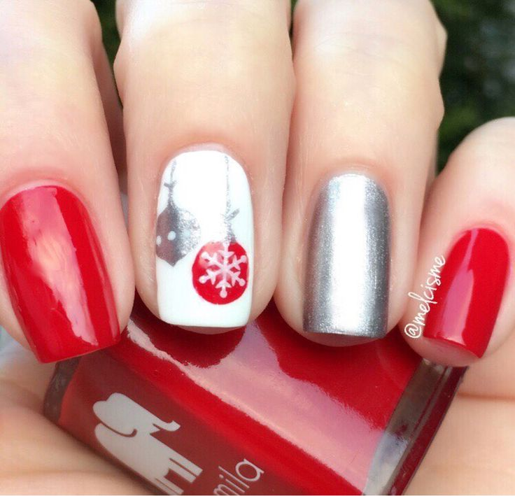 Getting into the holiday spirit with @melcisme's fabulous red, white and silver manicure using our Ornament Nail Art Stencils found at snailvinyls.com