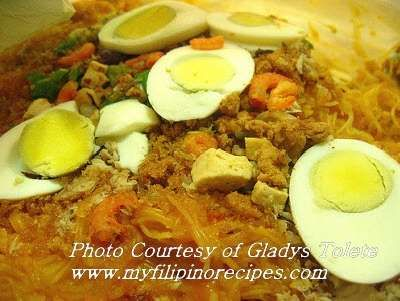 Picture of Pancit Palabok Recipe  Palabok Noodles and Sauce: 1/4 kilo miki noodles 1/4 cup annatto seeds 1/4 cup shrimps 4 tablespoons flour or cornstarch  Water Fish sauce  Palabok Toppings: Hard boiled egg; sliced Tinapa flakes (smoked fish) Pork chicharon; grounded Fried garlic; minced Spring onions; chopped Shrimps; boiled and shelled Lemon or kalamansi; sliced