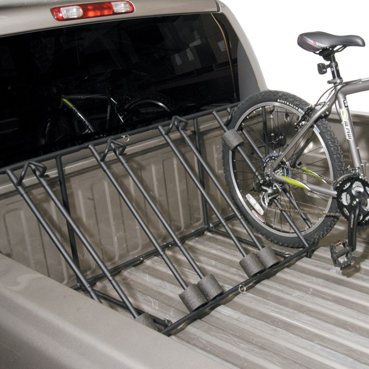 The Heininger Automotive 2025 Advantage SportsRack BedRack Bike Carrier holds up to four bikes in the bed of your pick-up truck. It secures fully assembled bikes quickly and easily for transport. This