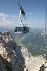 Der Zugspitz-Gipfel ist erschlossen von 3 Seilbahnen. Die erste, die Tiroler Zugspitzbahn von Ehrwald, wurde 1926 eröffnet, die Eibsee-Seilbahn von Grainau 1963 und die Bayerische Gletscherbahn 1992. Die Talstation der Tiroler Zugspitzbahn liegt im Westen am Fuße des Wetterstein-Massivs auf 1.225 m. Die Bahn überwindet einen Höhenunterschied von 1.725 m