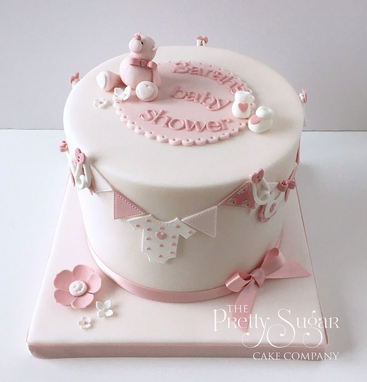 Pink baby shower cake with teddy and bunting