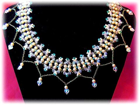 free necklace pattern; I'd like it better without bottom dangles (or maybe a smaller version of dangle?)