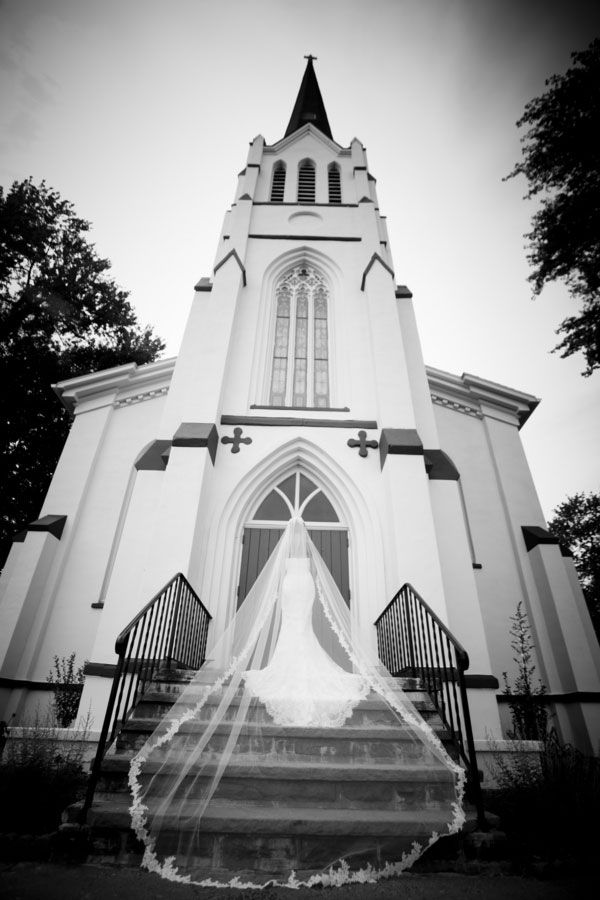 cathedral veil |  a to-die-for mantilla veil.  How glamorous is this black and white shot by the church?