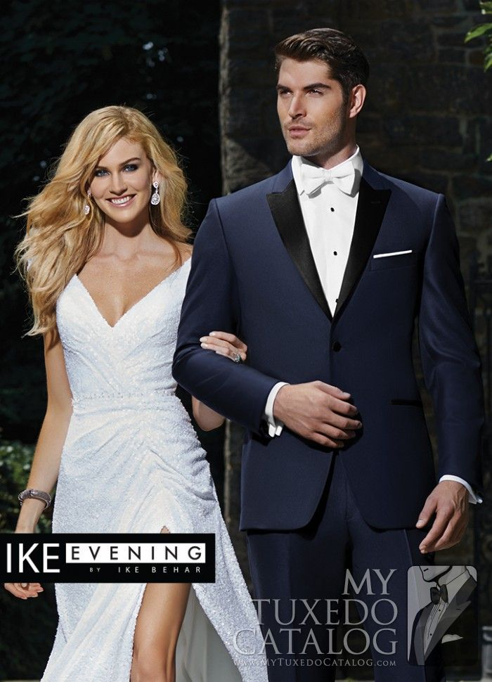 """<p style=""""text-align: left;"""">In recent years, one of the most emergent trends in men's formal wear has been the popularity of dark blue tuxedos and suits. To answer that growing need, Ike Behar Evening has developed some beautiful navy formal options!</p> <p style=""""text-align: left;"""">The Navy 'Blake' Tuxedo is a classy, attention grabbing navy formal favorite! Featuring a single button front, black satin peak lapels, black satin besom pockets, side vents, slim fit construction, and…"""