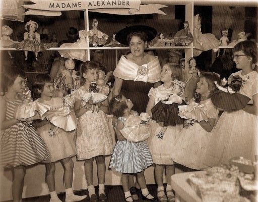 Vintage photo of little girls with dolls meeting Madame Alexander.