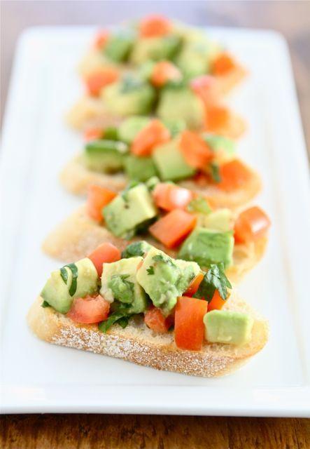 Guacamole Bruschetta Recipe on twopeasandtheirpod.com The perfect party appetizer!