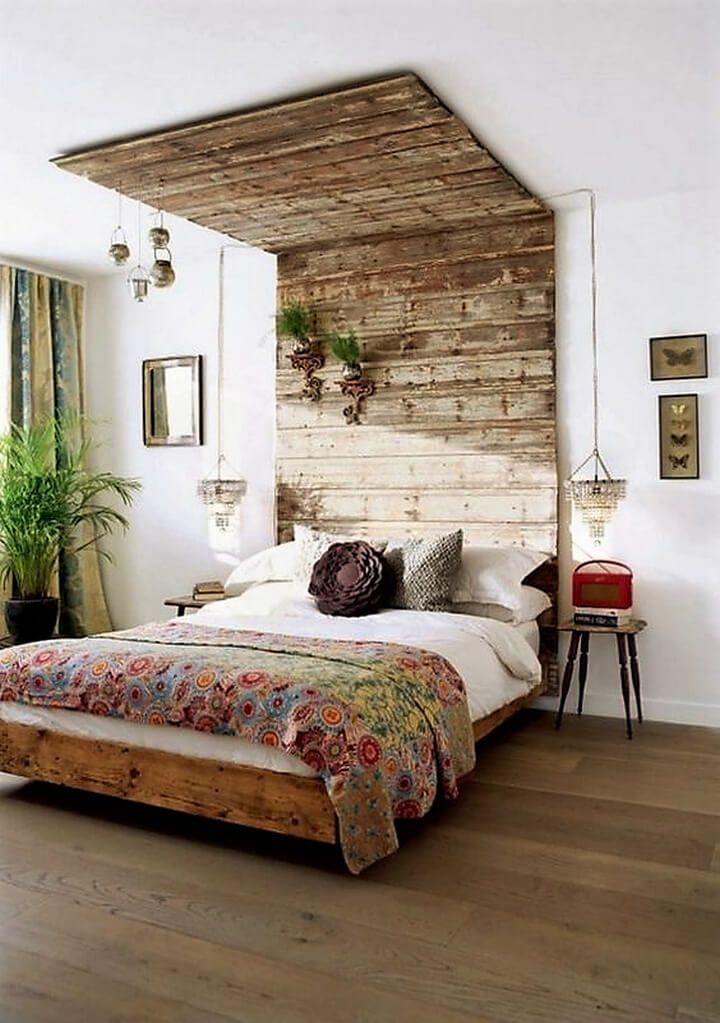 Here we have another pallet wood bed idea which is simple yet have bigger impact on your interior decor in the bed room. The headboard has been extended over to the ceiling of the room for an extended view. You can play with your creativity over that headboard area, hanging your favorite decorative pieces you love to see often.