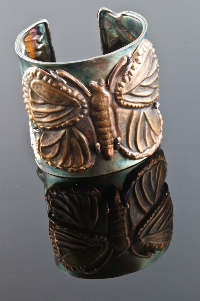 Diana Casabar--Butterfly Cuff Triptych  Chased and Repoussed monarch butterfly in copper.