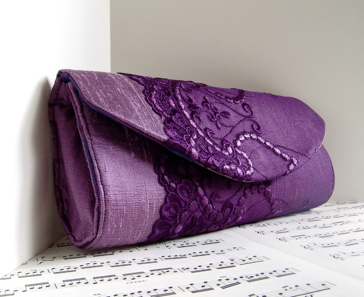 This would be perfect : White wedding dress, purple shoes and purple clutch :-) LOVE !