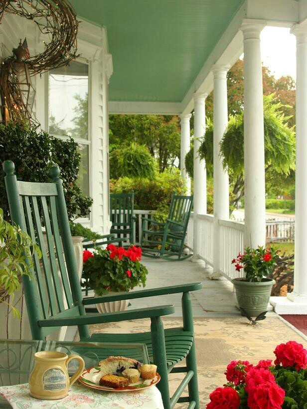 porch, rocking chairs, painted ceiling and maybe rails or long planters between the columns...
