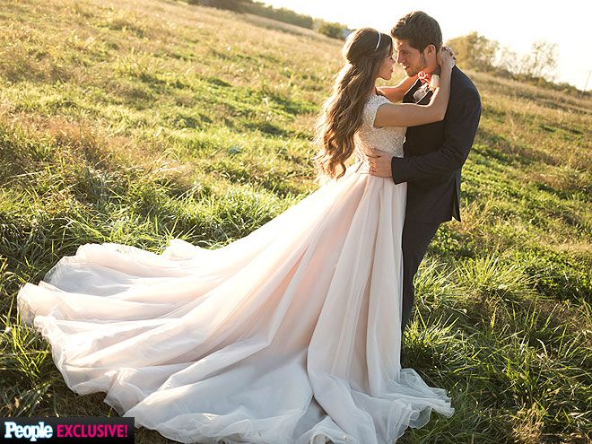 "10 Gorgeous Photos from Jessa Duggar & Ben Seewald's Wedding | THIS MAGIC MOMENT | The newlyweds take a wedding photo to remember as the sun sets outside of the church. ""This day is so exciting,"" Ben's mother Guinn says. ""It seems like a dream."""