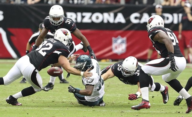 Philadelphia Eagles punt returner Damaris Johnson fumbles the punt while under pressure from the Arizona Cardinals defense who recovered the ball during the first half of their NFL football game in Phoenix, Arizona September 23, 2012. REUTERS/Darryl Webb