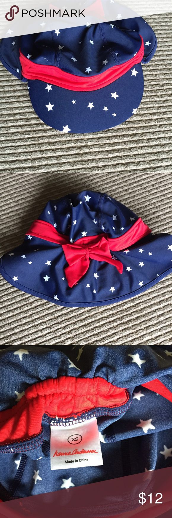 Hanna Andersson baby sun hat Blue hat with white stars and red band with bow in the back. Long back to cover baby's neck for better sun protection. Like new condition Hanna Andersson Accessories Hats