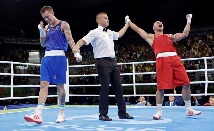 The agony of defeat:    Australia's Jason Whateley, left, and Brazil's Juan Nogueira react as Nogueira wins a men's light-heavyweight 81-kg preliminary boxing match Aug. 6.