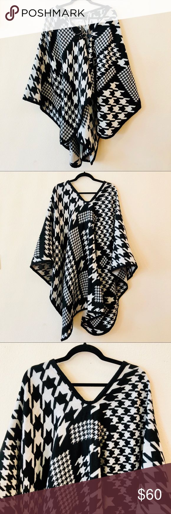 Andrew Marc Black N White Poncho Beautiful black and white geometrically patterned Andrew Marc poncho.  In mint condition.  Pay attention to the stirrup styled clasp in the front of the poncho. No detail was spared for this gorgeous piece of clothing.  Perfect for the winter weather or on days when it's warming up a bit! Small snag in fabric (pictured). Andrew Marc Sweaters Shrugs & Ponchos