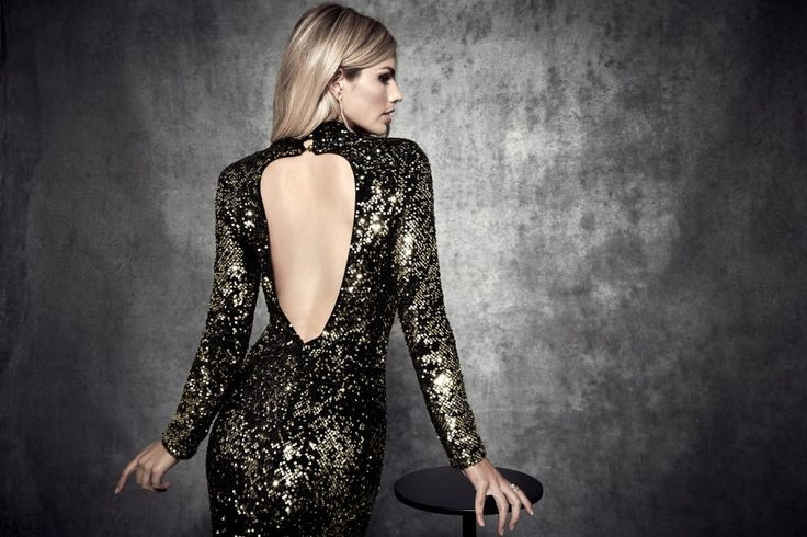 Make a dramatic entrance with this stunning sequin gown featuring long sleeves, a sultry open back and padded shoulders   MARCIANO.com