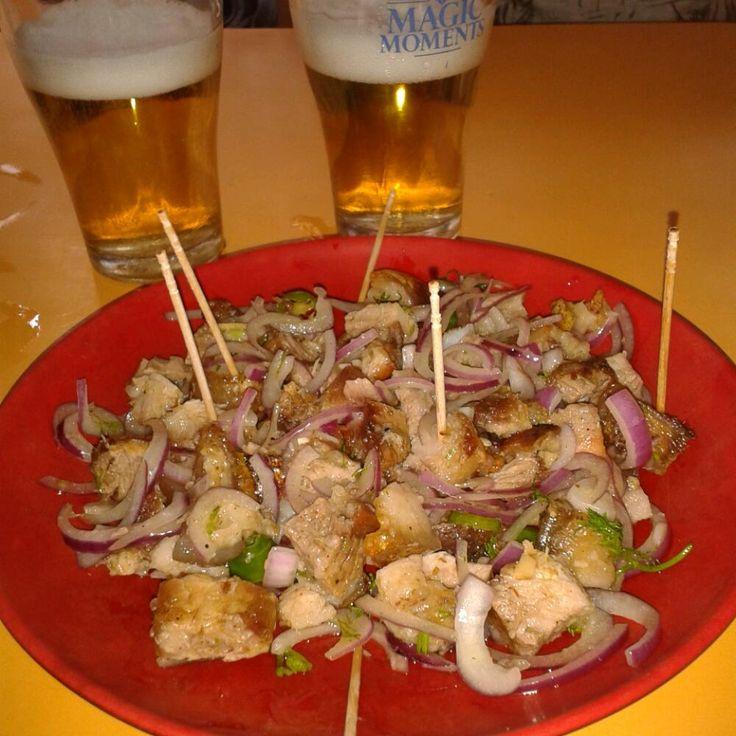 Pura gahori (Roast pork) with onions and green chilli pepper  @ kitchen bar and resturant , guwahati