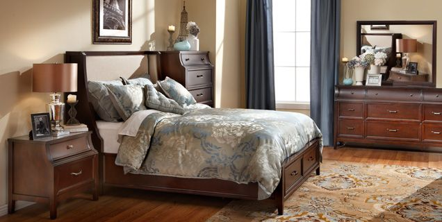 The Renaissance Bedroom Group in rich, brown finish with gunmetal hardware contrasts nicely with slate blue tones.