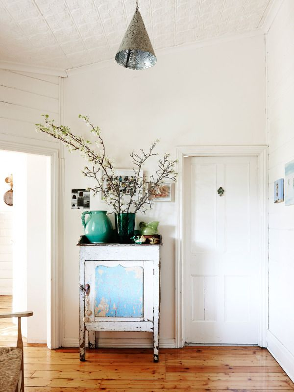 flowering branches, vintage style in the entry of the home of Sarah Murphy, Matthew McCaughey and Family as seen on The Design Files