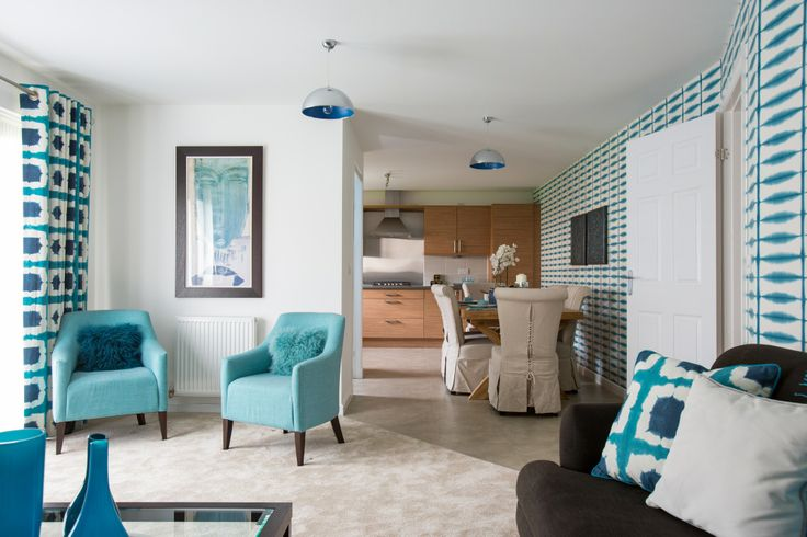 Open plan kitchen and family room with an aqua theme