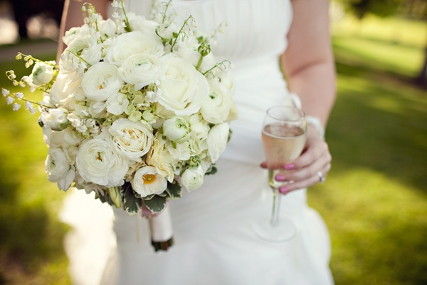 A Hey Gorgeous Events wedding with a beautiful big white ranunculus and Lily of the Valley bouquet. Photo by @Julie Forrest Harmsen Fitts