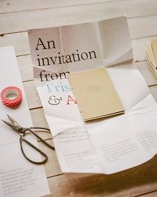 """The oversized invitations were folded around a petite """"Greek-Canadian book of cultural observations."""" The color palette was inspired by the two countries -- with blue-and-white and red-and-white sprinkled into the design."""