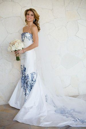 Delicate blue embroidery adds detail to this white wedding dress. Blue and white china themed wedding inspiration.