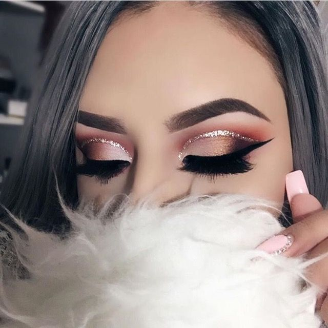 Coral and light pink eye makeup look, with a dramatic outer v and glitter liner.