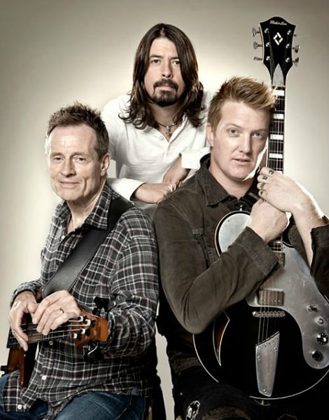 this makes me think of one of those awkward walmart photo studio pics hahah ....---  them crooked vultures :)