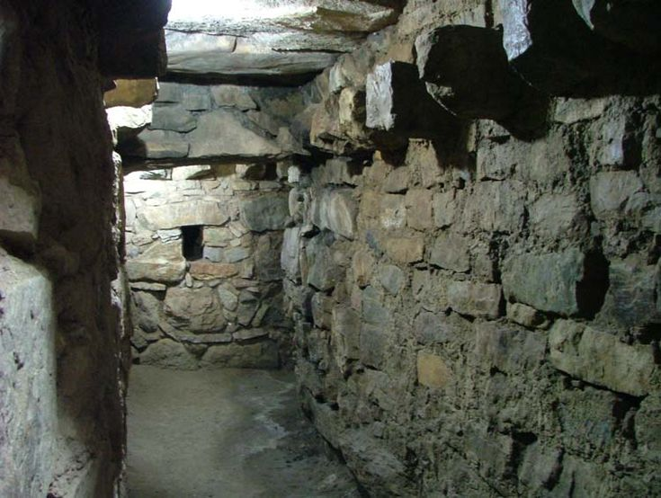 Tunnel under Chavin De Huántar.  Ancient Settlement in Peru. Chavín de Huántar is an archaeological site containing ruins and artifacts constructed beginning about 850 BCE and occupied to about 300 BCE by the Chavín, a major pre-Inca culture.