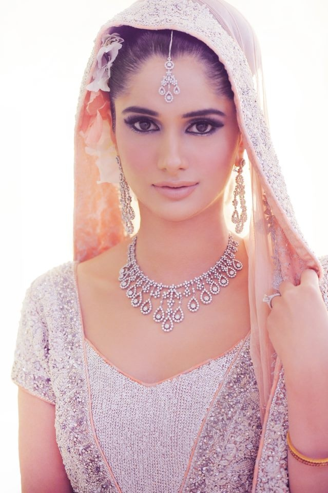 Blush lehenga and diamond jewelry
